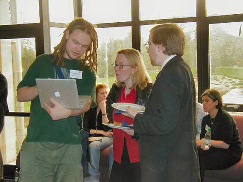 photo (70KB): Chris Gutteridge (left) talking to delegates in the break