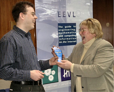 photo : (43KB) :Malcolm Moffat, EEVL Project Officer, giving a visitor a OneStep flyer at the Learning & Teaching Conference at Heriot Watt University