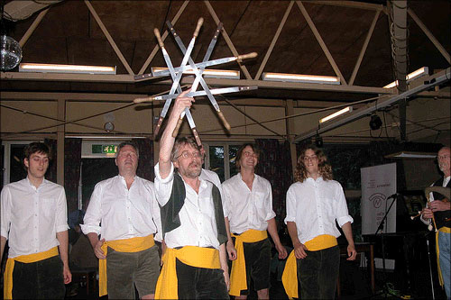 photo (55KB) : Brian Kelly giving a sword-dancing demonstration at the Workshop Barbeque - no delegates injured