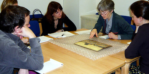 photo (39KB) : Figure 2 : E-Curator Workshop: object handling session discussing a painting by Walter Westley Russell