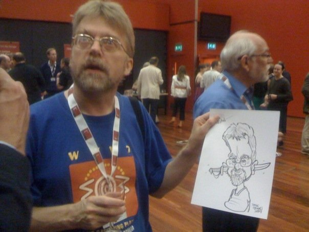 photo (47KB) : Figure 1 : Brian Kelly (left) with his caricature