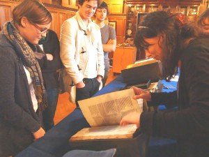 Figure 2: Dr Guyda Armstrong shows her students a selection of early printed editions of Dante. © Mimas, University of Manchester